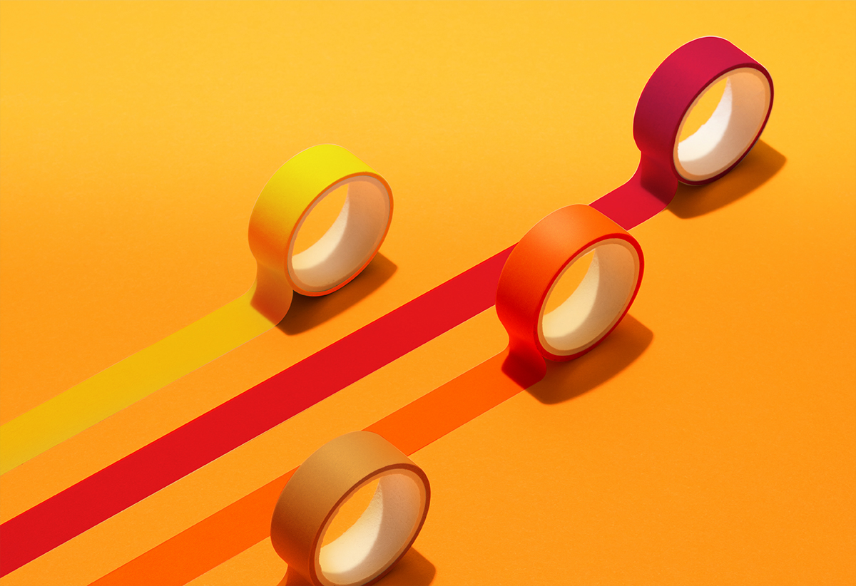 Moving Adhesive Tapes on Yellow Orange Colored Background High Angle View, Planning, Direction and Competition Concept.